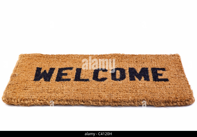 Photo of a welcome door mat isolated on a white background. - Stock Image