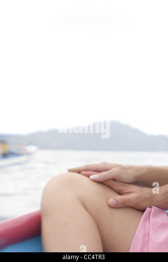 Couple on Boat Clasping Hands - Stock Image
