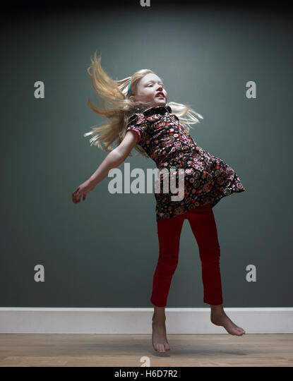 girl 3-5 jumping,  studio shot - Stock Image