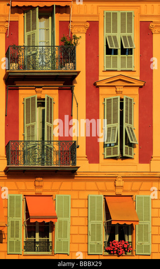 Typical French windows on residential building near the port in Nice France - Stock-Bilder