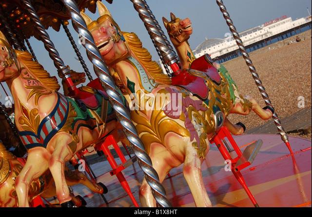 Fairground ride on Brighton Beach, East Sussex, England - Stock Image