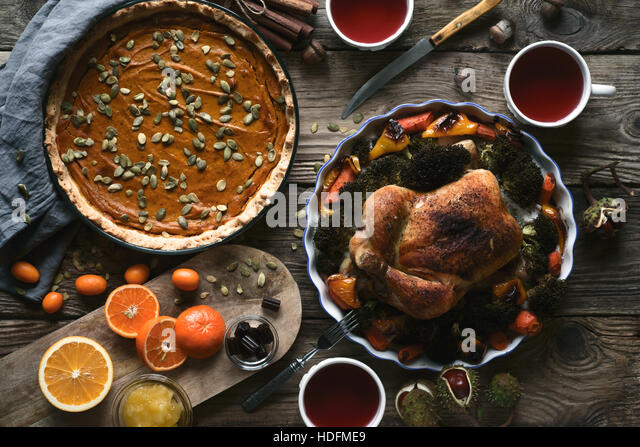 Wooden table served for Thanksgiving dinner top view - Stock Image