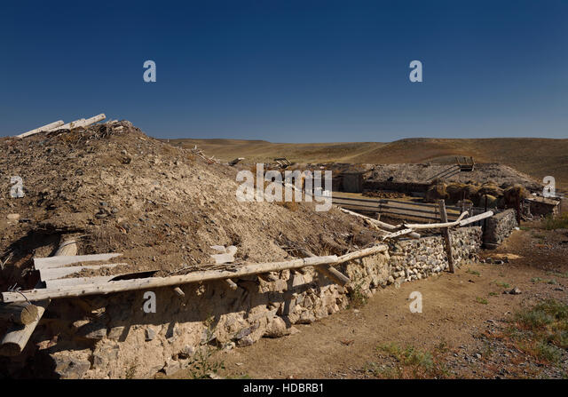 Stone wall and earthen roof stable at Black Canyon Charyn river Kazakhstan - Stock Image