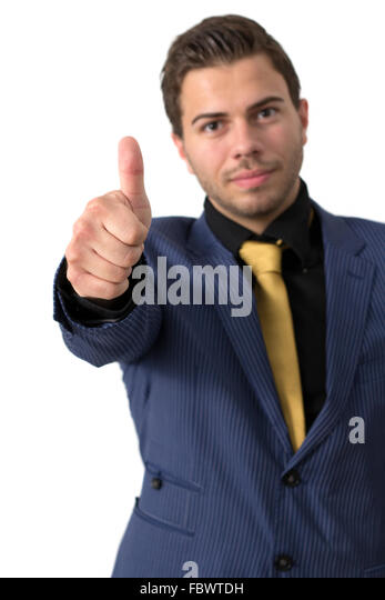A Young businessman showing thumb up - Stock Image