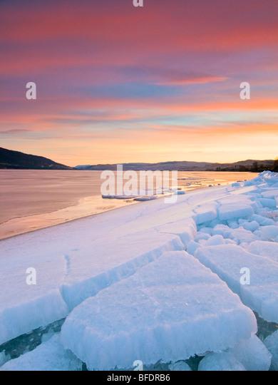 Ice break-up at sunrise, Nicola Lake, Merrit, British Columbia, Canada - Stock Image