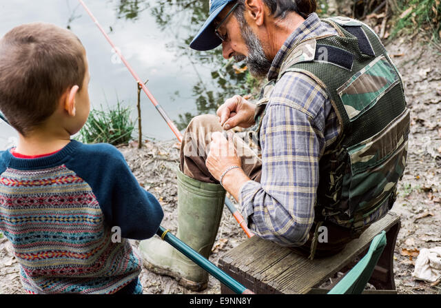 Man and his grandson fishing - Stock Image