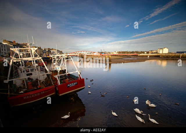 Red Fishing Boats In The Harbour Ramsey Isle Of Man - Stock Image