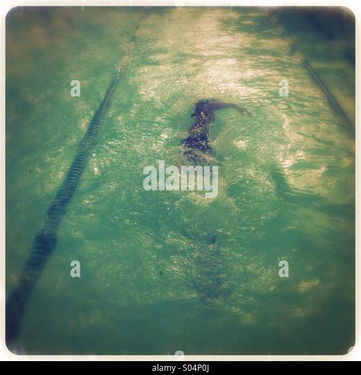Little boy swimming - Stock Image