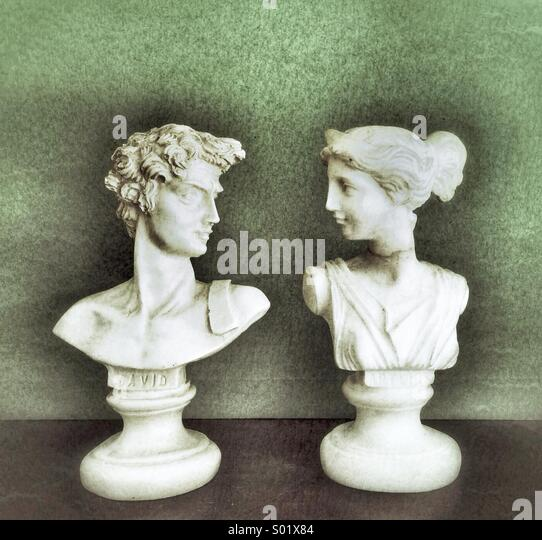 Happy couple of statues - Stock Image