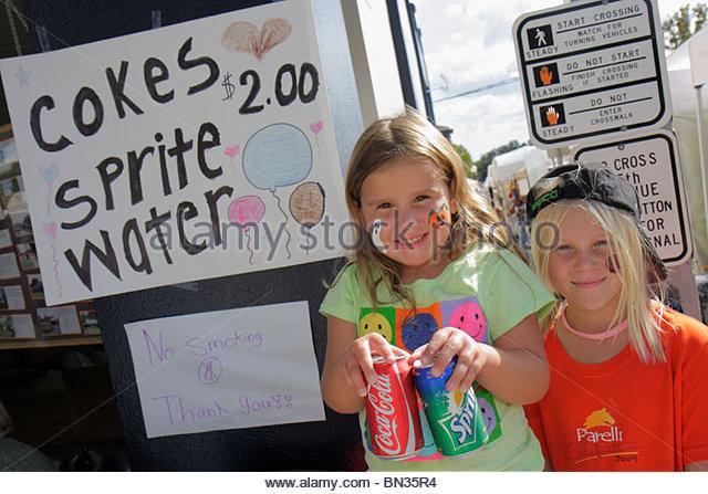 Mount Dora Florida Mt. Annual Craft Fair event community festival vendor young entrepreneur girl sister child student - Stock Image