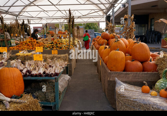 Pumpkins and squash for sale at the Jean Talon Market, Montreal, Quebec, Canada - Stock Image