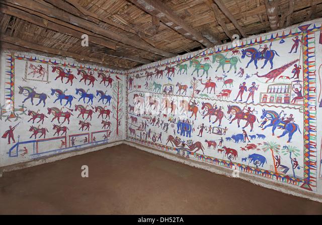 Tribal wall paintings (pithola painting), Bhil Tribe, Madhya Pradesh, India - Stock Image