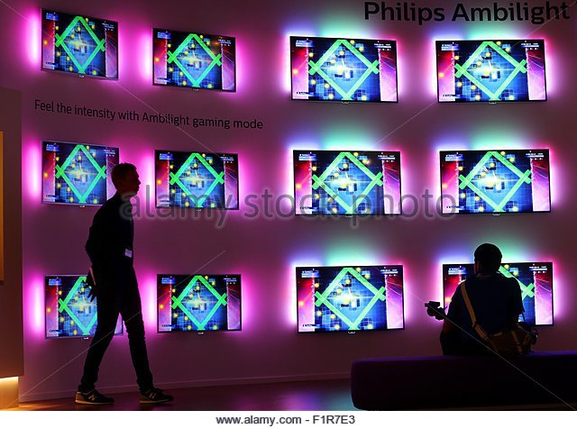 epa04910991 Philips demonstrates TV screens featuring so-called 'Ambilight' technology at the International - Stock Image