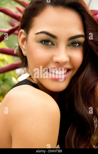 Portrait of young woman, wearing eye shadow, looking at camera - Stock Image