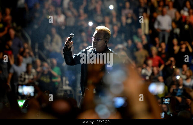 Berlin, Germany. 24th Sep, 2015. Singer Bono (Paul David Hewson) of Irish rock band U2 performs on stage during - Stock Image