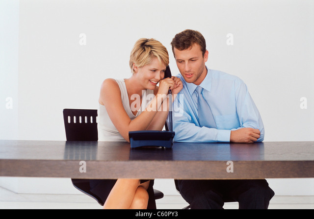 Business people talking on telephone - Stock Image