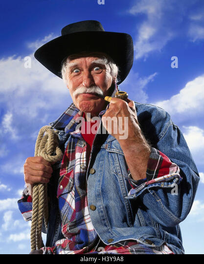 Senior, 'cowboy', whistle, lasso, facial play, decided, energetically, half portrait, cloudy sky Senior, - Stock Image