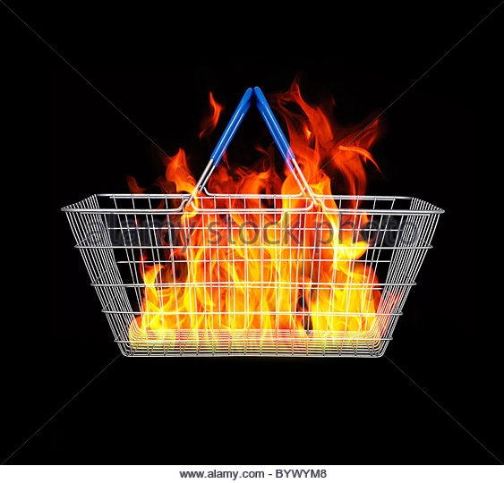 Fire inside shopping basket - Stock-Bilder