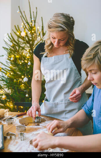 Finland, Couple preparing christmas cookies - Stock Image