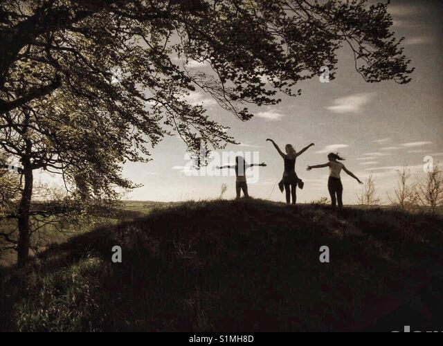 Children's Silhouette at sunset - Stock Image