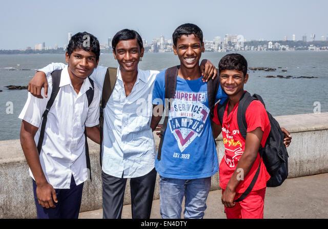 Mumbai India Asian Churchgate Marine Drive Back Bay Arabian Sea teen boy student friends smiling - Stock Image