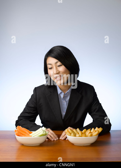 Businesswoman deciding what to eat - Stock-Bilder