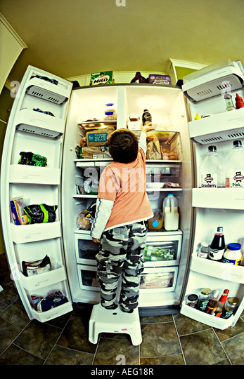 Raiding the fridge - Stock Image