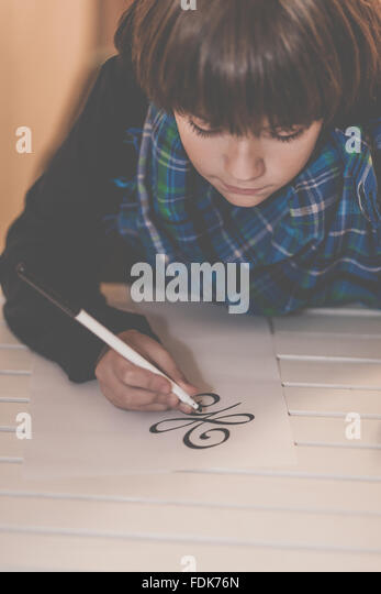 Boy drawing the new beginning symbol - Stock Image