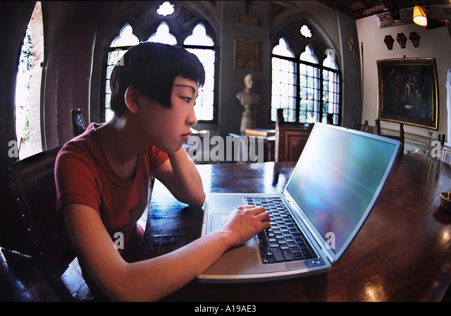 Young Woman and computer - Stock Image
