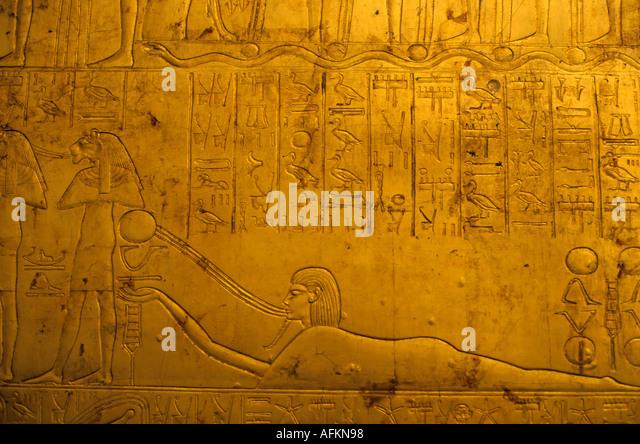 Hieroglyphics on Tutankhamun's gold tomb at the Egyptian Museum in Cairo, Egypt. - Stock Image