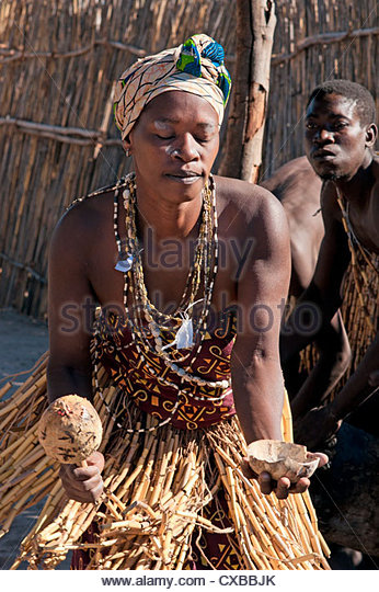 Local woman dancing with gourd rattle, Kxoe village, Kwando river area, Caprivi Strip, eastern Namibia, Africa - Stock Image