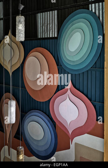 Decorative, multicolored and artistically shaped wooden wall plaques - Stock-Bilder