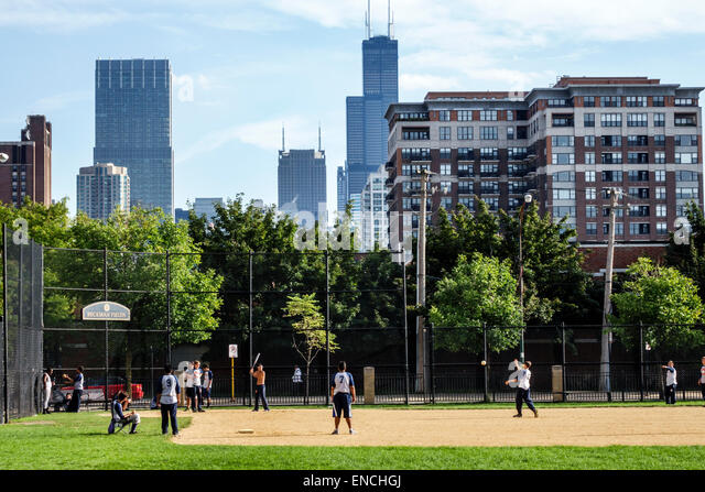 Chicago Illinois North Side Old Town neighborhood community area Beckman Field baseball field park team sport boy - Stock Image