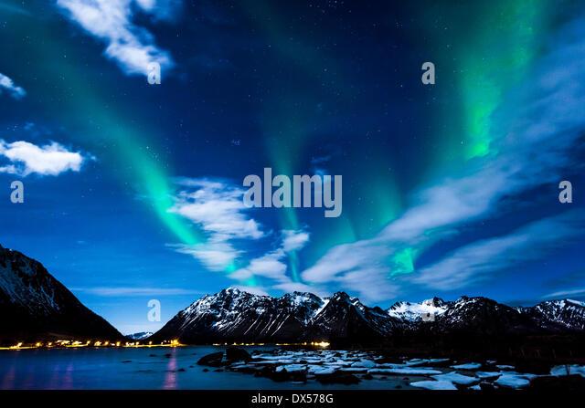 Northern Lights or Aurora Borealis, on the coast of Gimsøy, Gimsøya, Lofoten, Norway - Stock Image