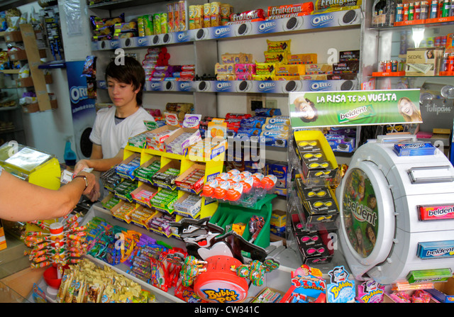 Mendoza Argentina Avenida San Juan convenience store business counter candy breath mints Hispanic boy teen fashion - Stock Image