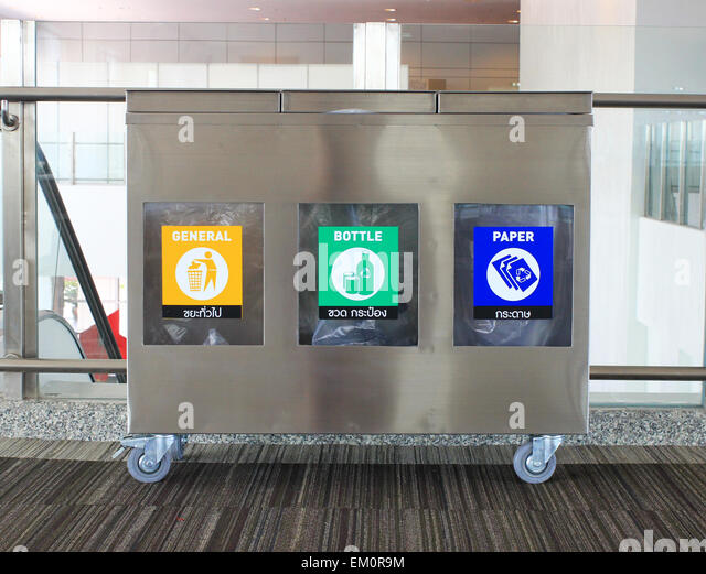 Metal garbage bin in building - Stock Image
