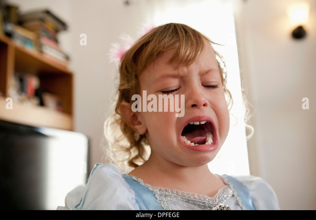 Close up of female toddler crying - Stock Image