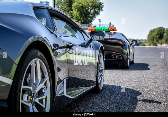 Black Lamborghini Huracan lead and safety cars on circuit asphalt track before start motor sport racing - Stock Image