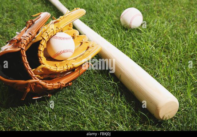 Baseball equipment on grass - Stock Image