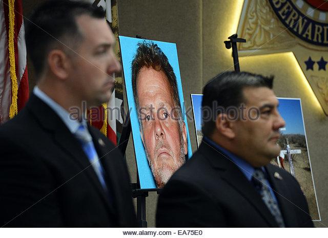 San Bernardino, California, U.S. 7th Nov, 2014. A booking photo of Charles 'Chase' Merritt sits behind detectives - Stock Image