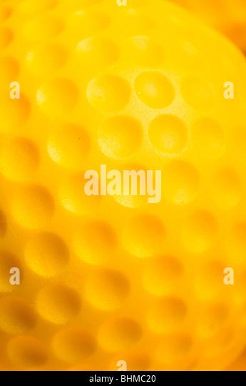 macro detail of a yellow golf ball - Stock Image