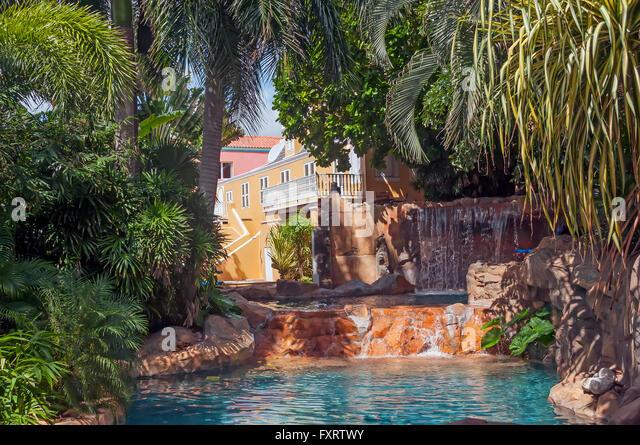 Kura Hulanda village with waterfall, small pool and dense green foliage, Otrobanda Willemstad Curacao - Stock Image