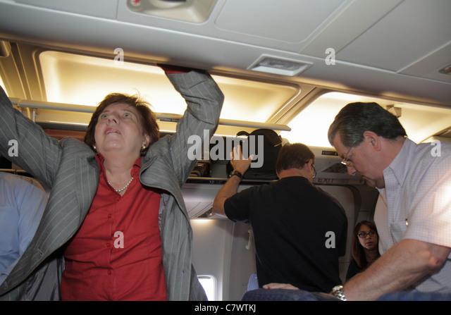 Nicaragua Managua Augusto C. Sandino International Airport MGA aviation cabin arrival disembark American Airlines - Stock Image