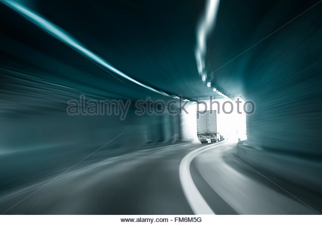 Tunnel dangerous high speed truck driving motion blur blue color