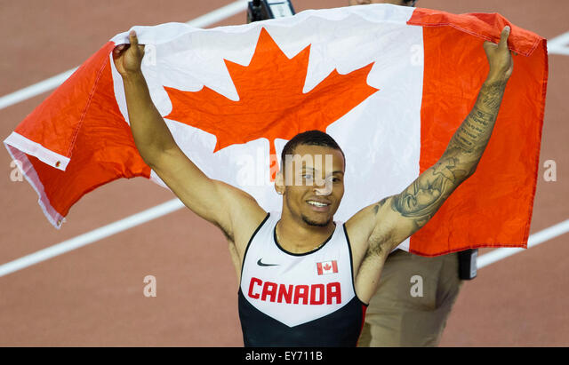 Toronto, Canada. 22nd July, 2015. Andre De Grasse of Canada celebrates after winning the men's 100m final race - Stock-Bilder