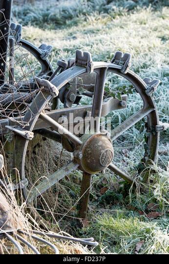 Frost on a vintage bamford potato spinner in an allotment. Uk - Stock Image