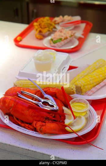 Massachusetts Plymouth Water Street Town Wharf Lobster Hut restaurant seafood tray dinner counter inside food corn - Stock Image