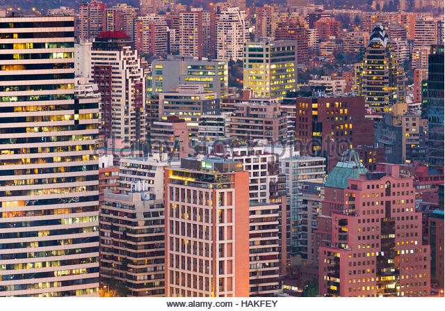 Rooftops of residential and office buildings at dusk in Providencia and Las Condes districts in Santiago de Chile - Stock Image