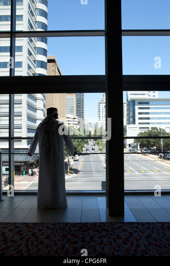 Arab businessman looking out window. - Stock Image