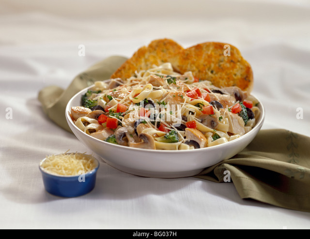 Chicken pasta primavera with parmesan cheese - Stock Image